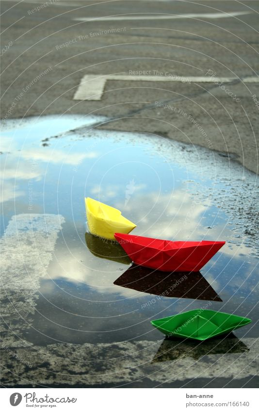 wreck Colour photo Deserted Day Water Wet Yellow Green Red Joy Paper Paper boat Playing Reflection Lake Parking lot Puddle Float in the water Swimming & Bathing