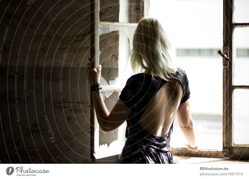 Human being Youth (Young adults) Old Young woman Window 18 - 30 years Adults Wall (building) Feminine Building Wall (barrier) Fashion Elegant Blonde Stand Back