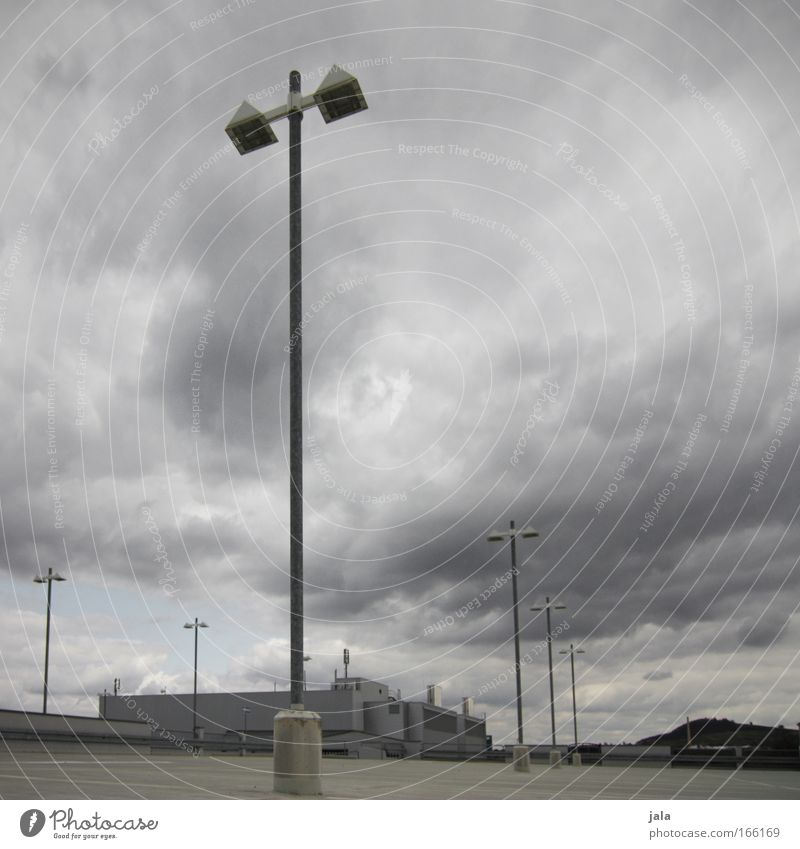 Sky Clouds Loneliness Dark Gray Building Fear Architecture Wind Empty Threat Gale Manmade structures Storm Parking lot