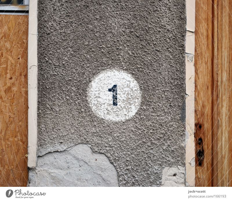 ONE in a circle Wall (building) Stone wood Sign Signs and labeling 1 Simple Gray White Orderliness Surface Circle Weathered Fracture point Mortar bailer