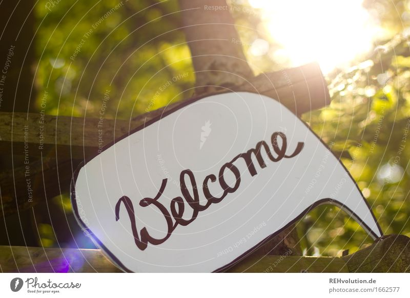 welcome Environment Nature Tree Forest Sign Characters Signs and labeling Signage Warning sign Free Friendliness Warmth Green Joie de vivre (Vitality) Trust