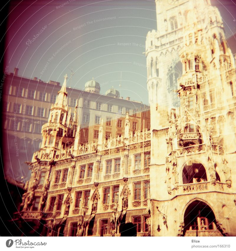 Analogue double exposure of the Munich City Hall with the towers of the Frauenkirche on it on the Marienplatz Old town City hall Tourist Attraction Threat
