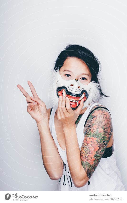 Human being Youth (Young adults) Beautiful Young woman 18 - 30 years Adults Funny Feminine Happy Hair Happiness Cool (slang) Peace T-shirt Tattoo Mask