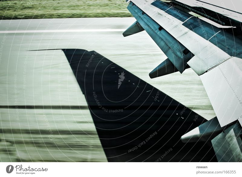 landing Colour photo Subdued colour Day Aviation Airplane Airport Runway Airplane landing Airplane takeoff In the plane View from the airplane Speed Wing Brakes