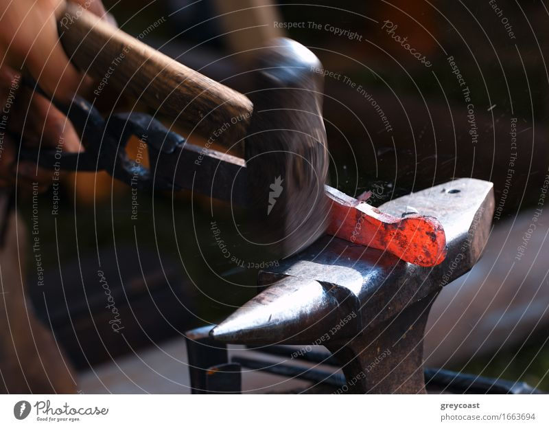 Blacksmith at work. Human being Old Hand Red Dark Black Art Bright Work and employment Metal Dirty Power Retro Industry Hot Tradition