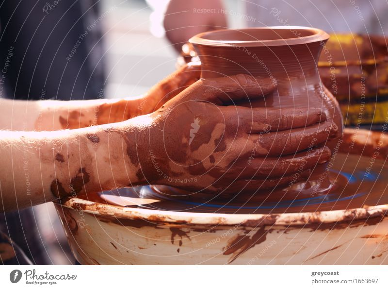 Potter making the pot in traditional style. Close up. Bowl Handicraft Work and employment Craft (trade) Human being 1 Art Culture Make Dirty Retro Brown