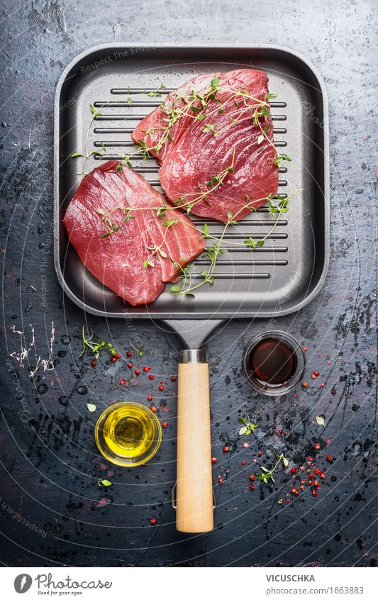 Grill pan with two raw tuna steaks Food Fish Herbs and spices Cooking oil Nutrition Lunch Dinner Buffet Brunch Banquet Business lunch Organic produce