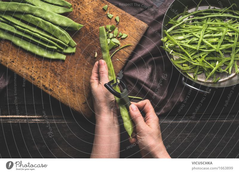 Female hands cut beans with vegetable peeler . Food Vegetable Nutrition Lunch Dinner Organic produce Vegetarian diet Diet Pot Knives Style Healthy Eating Life