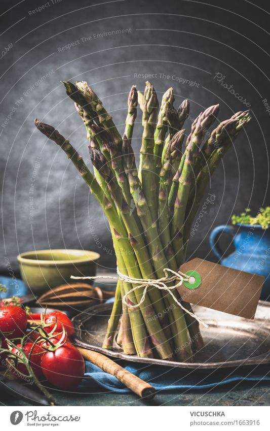 bundles of green asparagus on the kitchen table Food Vegetable Herbs and spices Nutrition Organic produce Diet Crockery Plate Bowl Pot Cutlery Spoon Lifestyle