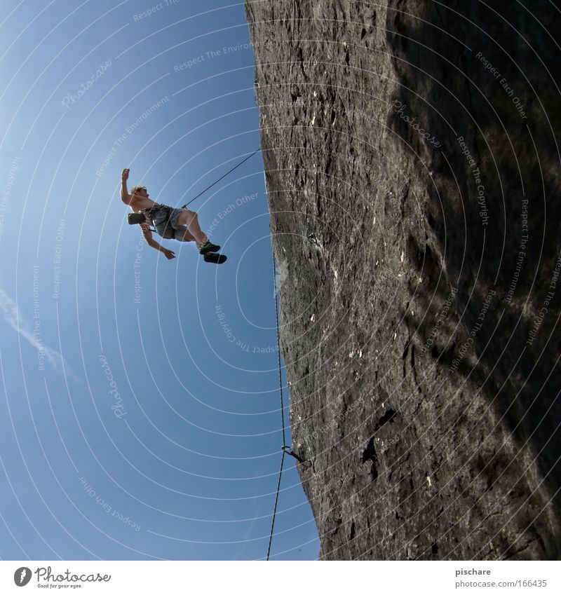 Human being Man Blue Adults Sports Mountain Fear Rock Leisure and hobbies Rope Adventure Dangerous Crazy Threat Climbing To fall