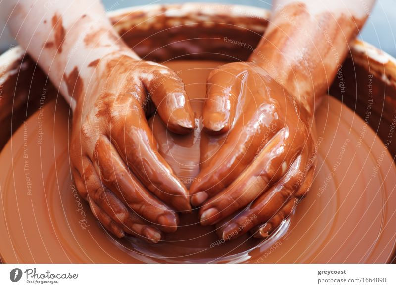 Potter making the pot. Bowl Handicraft Work and employment Craft (trade) Human being 1 Art Culture Sphere Make Dirty Retro Brown Creativity Tradition pottery