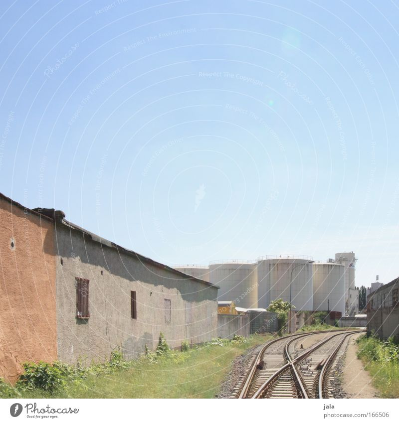 Sky Architecture Building Bright Railroad Manmade structures Factory Railroad tracks Industrial plant Switch Train travel Rail transport Freight train
