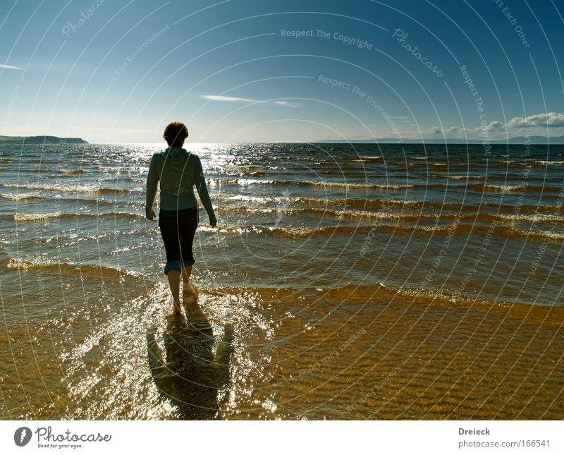 Human being Sky Water Blue Sun Ocean Beach Far-off places Life Freedom Movement Warmth Coast Lake Dream Bright