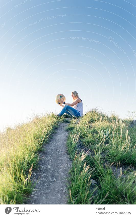 Young blonde woman on hill with globe in hands Lifestyle Style Leisure and hobbies Vacation & Travel Adventure Far-off places Freedom Expedition Summer