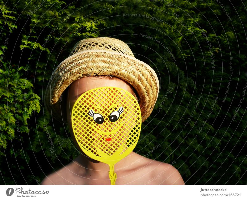 CAMOUFLAGE Colour photo Exterior shot Copy Space right Day Sunlight Portrait photograph Face Child Boy (child) Infancy Head 1 Human being 8 - 13 years Summer
