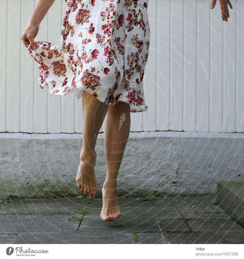 Human being Woman Beautiful Joy Adults Wall (building) Life Emotions Feminine Lifestyle Legs Wall (barrier) Fashion Feet Facade Jump