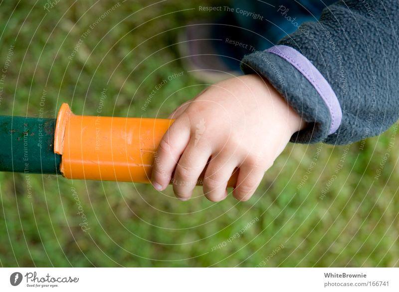 Miss Griffin Colour photo Exterior shot Day Shallow depth of field Toddler Hand 1 Human being 1 - 3 years Grass Steel Plastic Touch