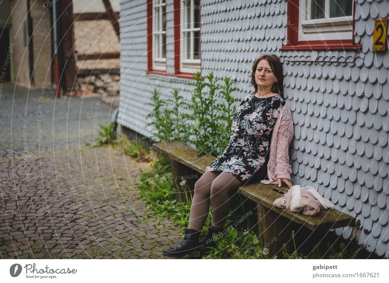 Human being Woman Relaxation House (Residential Structure) Window Adults Life Feminine Germany Facade Contentment Leisure and hobbies Idyll Sit Europe Wait