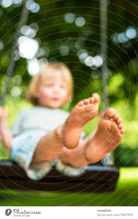 Summer Picture Joy Healthy Contentment Relaxation Leisure and hobbies Playing Swing Summer vacation Sun Sports Toddler Parents Adults Legs Feet To enjoy
