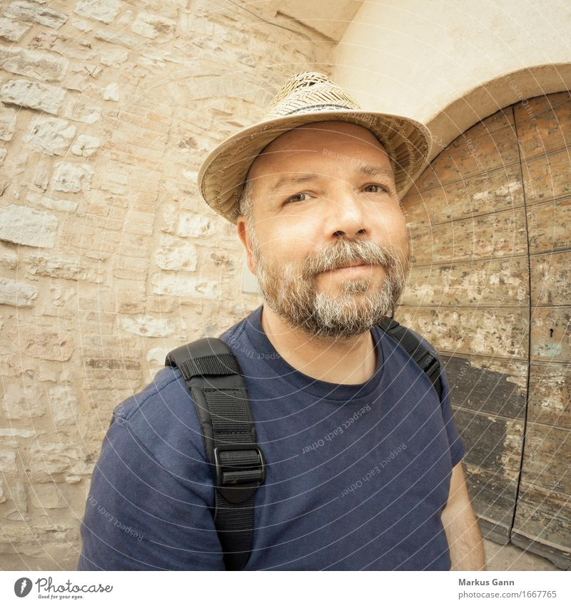 Man with beard and straw hat Wall (barrier) Wall (building) Door T-shirt Straw hat Hat Facial hair Beard Brown Beige Backpack Grinning Calm Congenial