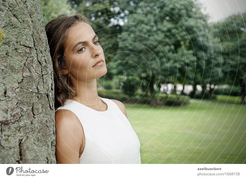 sad young woman leaning against tree Human being Woman Nature Youth (Young adults) Green Young woman Tree Loneliness 18 - 30 years Adults Sadness Emotions