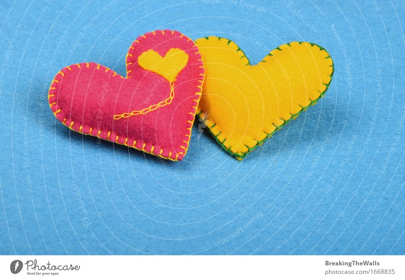 two handmade FELT hearts, pink and yellow together on blue Blue Yellow Love Small Art Together Pink Leisure and hobbies Creativity Heart Romance Soft Wedding