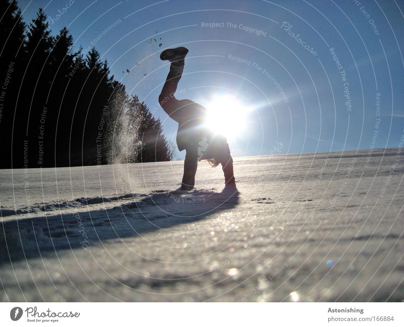 KÜHL-MAN 3 Colour photo Exterior shot Day Light Shadow Contrast Sunlight Full-length Looking away Leisure and hobbies Playing Winter sports Human being