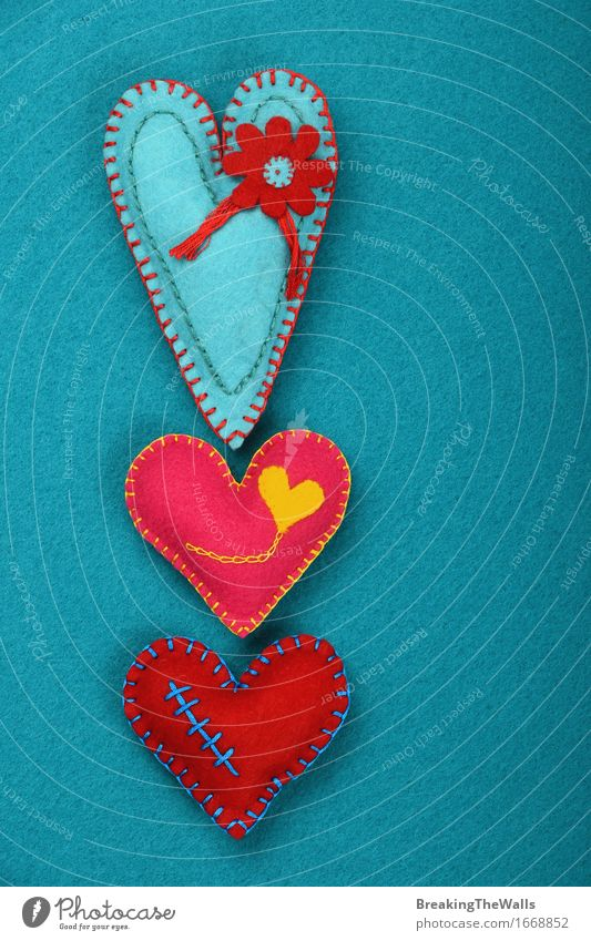 Three stitched toy hearts, pink, red and teal on blue felt Leisure and hobbies Handcrafts Valentine's Day Mother's Day Art Work of art Toys Heart Love Together