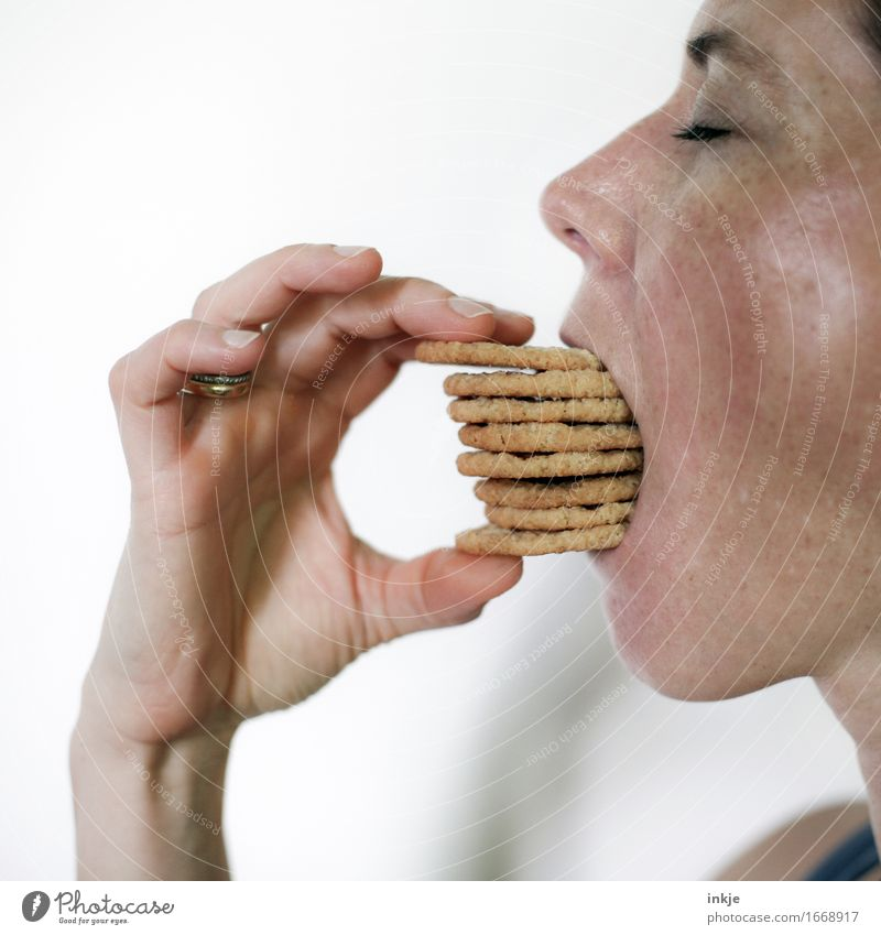 Woman eating a stack of cookies Dough Baked goods Candy Cookie Nutrition Eating Adults Life Face Hand 1 Human being 30 - 45 years To hold on Many Emotions