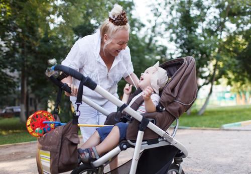Granny playing with her grandson in pram Lifestyle Joy Happy Beautiful Playing Garden Child Human being Baby Boy (child) Woman Adults Female senior Mother