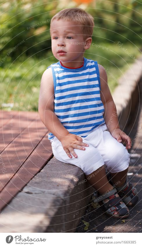 Cute boy sitting on the curb Lifestyle Face Summer Child Human being Baby Toddler Boy (child) Infancy 1 1 - 3 years Park Garden Street Blonde Sit Small kid one