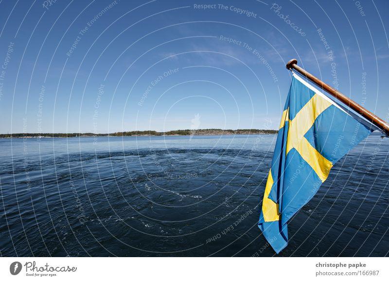 Swedish flag, in the background water and islands of the archipelago off Stockholm Swede Flag Skerry archipelago garden Scandinavia Landscape Island Fjord Trip