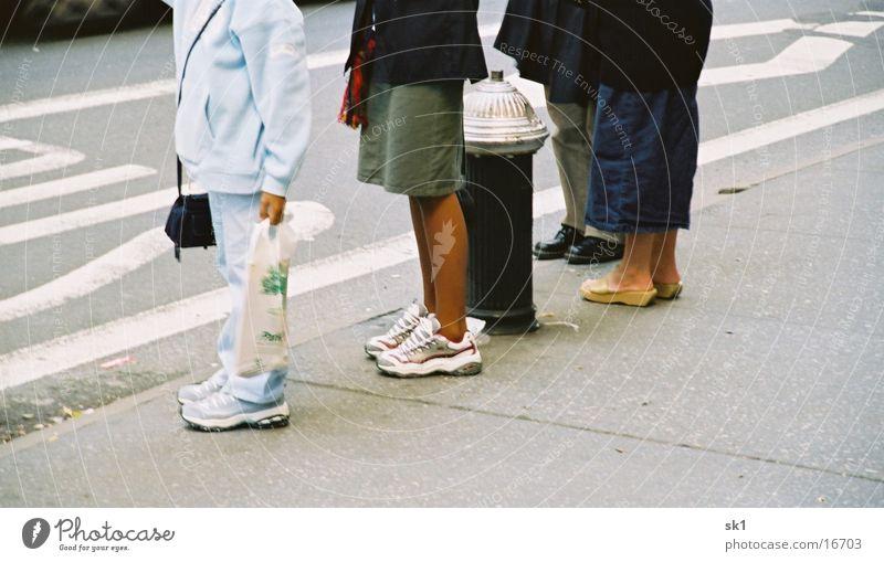 Human being Street Dark Group Footwear Legs Bright Wait Sidewalk Queue Lanes & trails Bus stop Fire hydrant