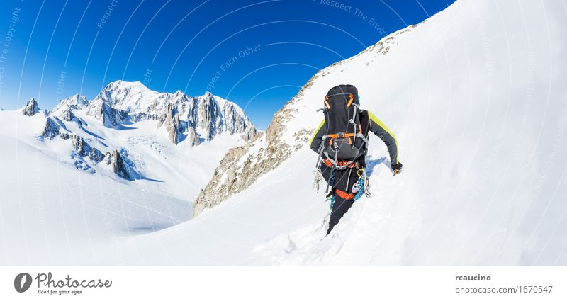 Mountaineer climbs a snowy peak. Chamonix, France, Europe. Human being Nature Vacation & Travel Man White Landscape Loneliness Winter Adults Cold Sports Snow