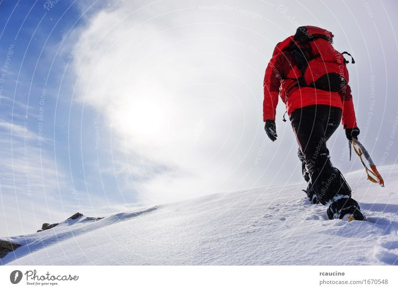 Mountaineer climbing a snowy peak in winter season. Vacation & Travel Adventure Expedition Winter Snow Hiking Sports Climbing Mountaineering Success Human being