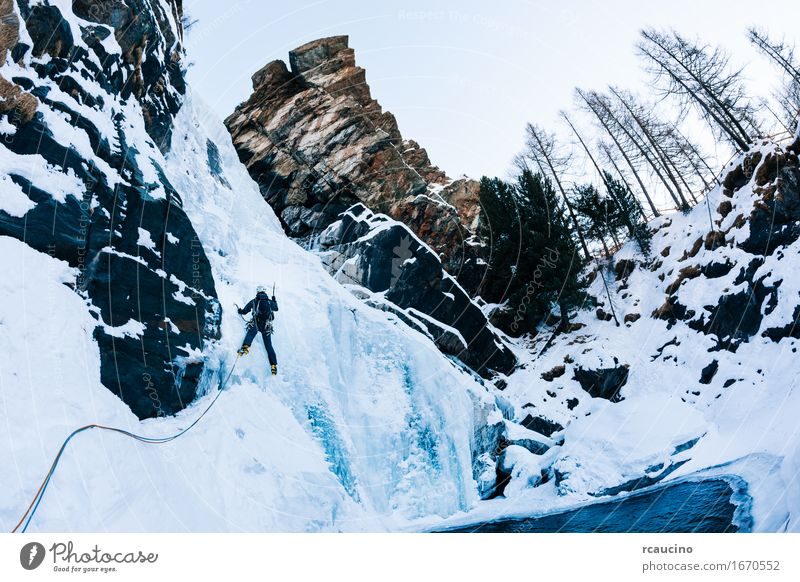 Ice climbing: male climber on a icefall Human being Nature Vacation & Travel Man Colour White Landscape Loneliness Winter Mountain Adults Sports Snow Lake Tourism Power