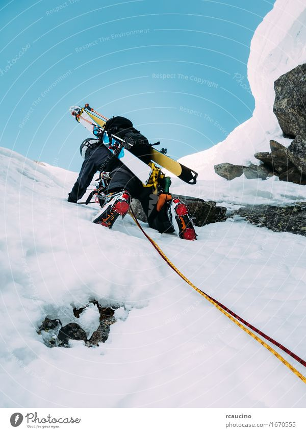 Ice climbing: mountaineer on a mixed route of snow and rock Human being Nature Vacation & Travel Man Landscape Loneliness Joy Winter Black Mountain Adults Cold