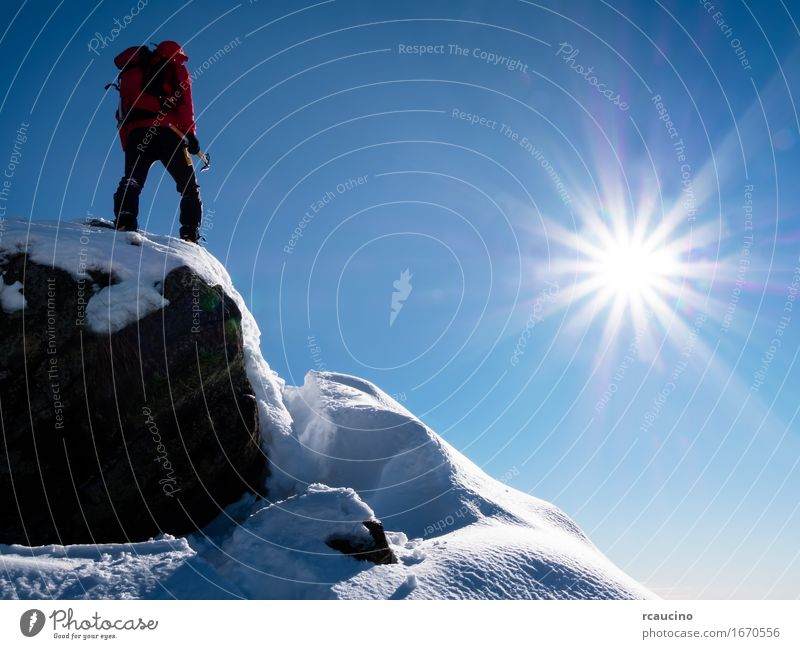 Mountaineer celebrates the conquest of the summit. Human being Sky Nature Vacation & Travel Man Blue Sun Landscape Red Joy Winter Adults Sports Freedom Power