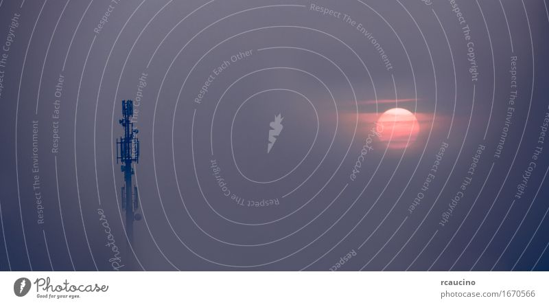 Mobile phone antenna tower emerges from the fog Sun Industry Telecommunications Business Telephone Cellphone Technology Internet Sky Building Antenna