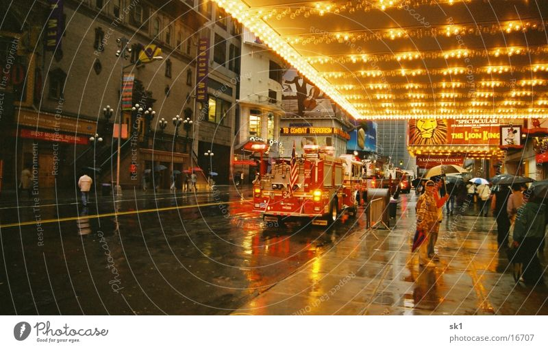 Fire brigade in NY Wet New York City Fire department Lion King light blanket Morning FDNY Deployment Road traffic Alarm Bad weather City light