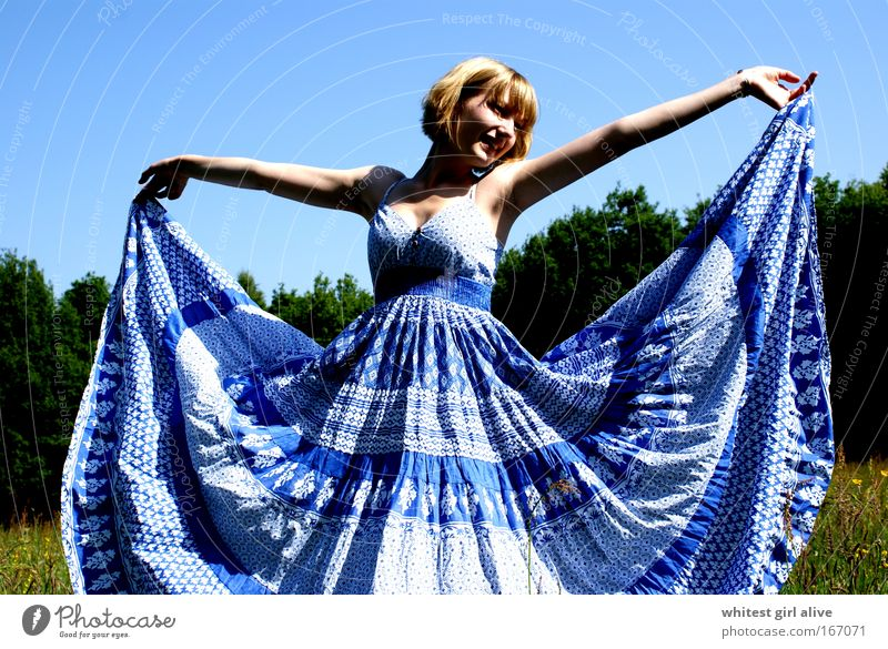 Human being Youth (Young adults) Blue Happy Elegant Happiness Stand Smiling Hip & trendy Young woman