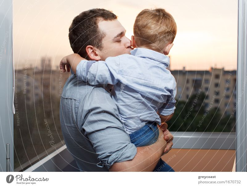 Thirty year old father kisses his three year old son on the balcony Lifestyle Joy Happy Face Vacation & Travel Sun Parenting Child Human being Boy (child)