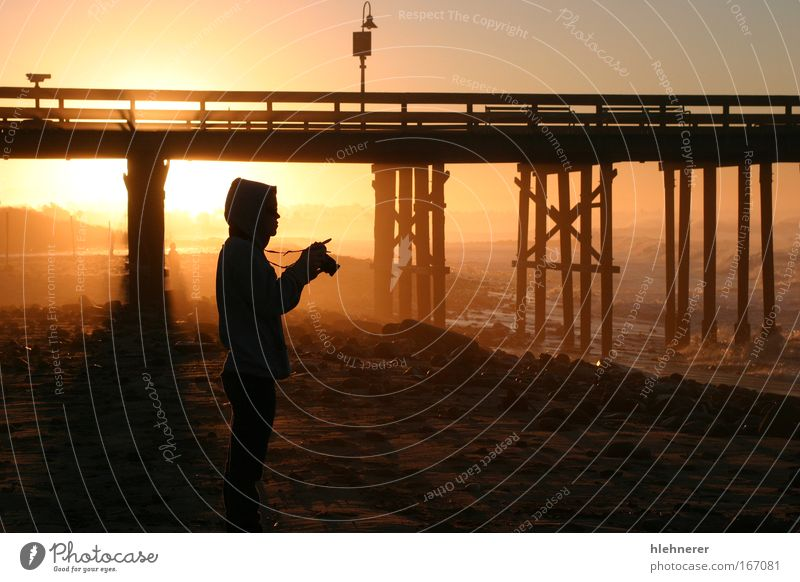 Photographer At Sunset Human being Sky Man Nature Ocean Beach Colour Adults Moody Orange Stand Camera Snapshot Dusk Photographer Outline
