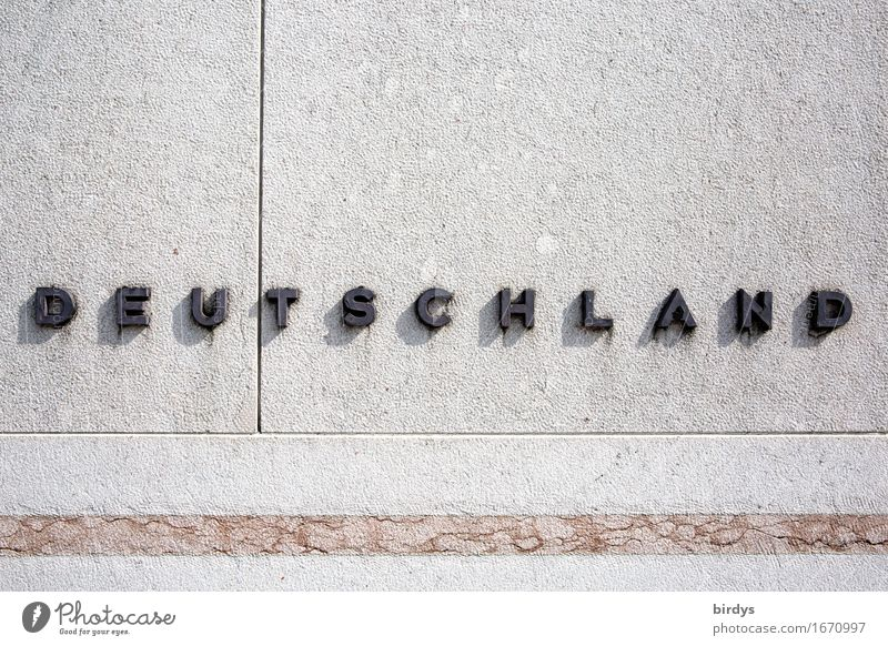conservative Germany Wall (barrier) Wall (building) Stone Metal Characters Line Esthetic Simple Positive Gray Black Self-confident Advancement Society Identity