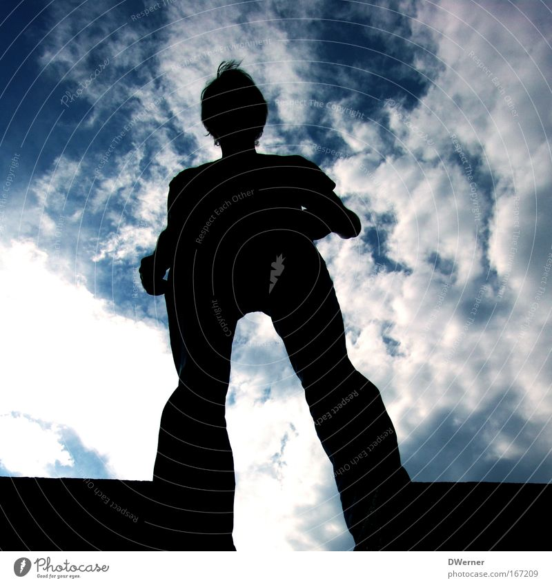 Human being Sky Man Youth (Young adults) Summer Clouds Calm Adults Far-off places Relaxation Life Wall (building) Freedom Above Jump Stone