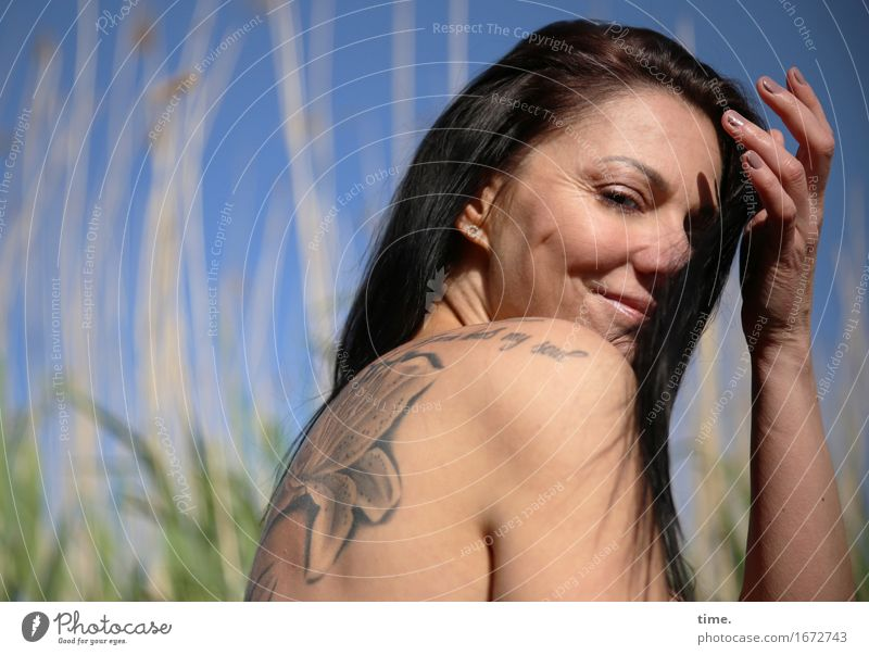 . Feminine 1 Human being Beautiful weather Common Reed River bank Beach Tattoo Black-haired Long-haired Observe Relaxation Smiling Looking Wait Emotions