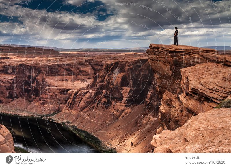 Deep abyss Vacation & Travel Adventure Woman Adults 1 Human being Nature Landscape Sky Storm clouds Horizon Rock Canyon Glen Canyon Grand Canyon Horseshoe Bend