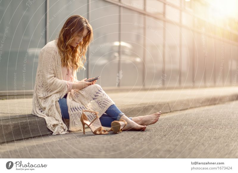 Trendy young woman woman using mobile phone Woman Beautiful Relaxation Face Adults Street To talk Lifestyle Copy Space Hair Sit Reading Telephone Hip & trendy Long Fatigue