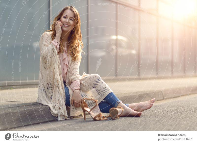 Trendy young woman woman using mobile phone Human being Woman Youth (Young adults) Beautiful Relaxation 18 - 30 years Face Adults Street To talk Lifestyle Copy Space Hair Sit Happiness Smiling