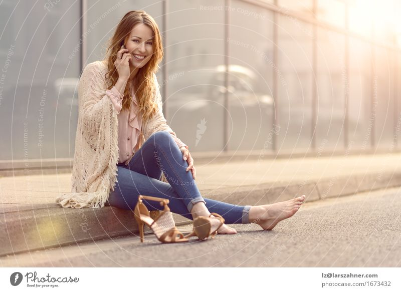 Trendy young woman using mobile phone Human being Woman Youth (Young adults) Beautiful Relaxation 18 - 30 years Face Adults Street To talk Feminine Lifestyle Copy Space Hair Sit Happiness